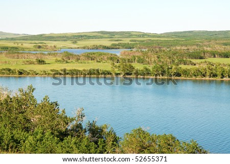 Summer view of prairies and lake in glacier national park, montana, usa - stock photo
