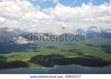 Summer view of rocky mountains and lake in lights and shadows, kananaskis country, alberta, canada