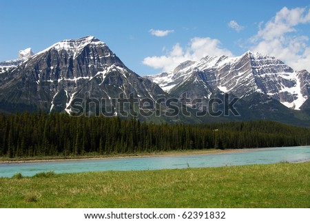 Summer view of rocky mountains and river in jasper national park, alberta, canada - stock photo