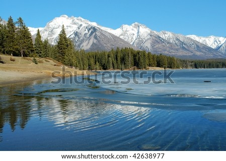 Summer view of rocky mountains around lake minnewanka, banff national park, alberta, canada - stock photo