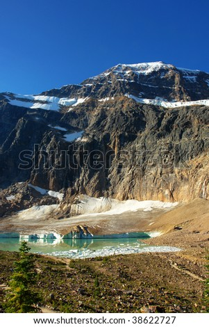 Summer view of rocky mountains, glacier and lake in mountain edith cavell in august, jasper national park, alberta, canada - stock photo