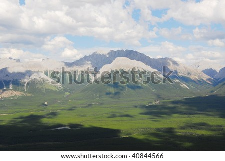 Summer view of rocky mountains in lights and shadows, kananaskis country, alberta, canada