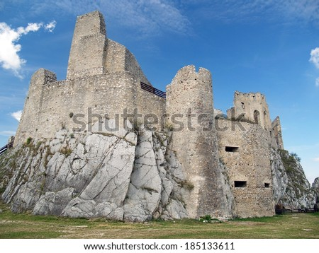 Summer view of ruined castle of Beckov situated in Beckov village, located in western Slovakia. The castle of Beckov is opened to public and it is definitely worth the travel.