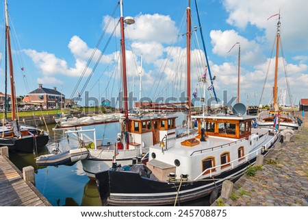 Summer view of the Dutch Hindeloopen harbor in the province of Friesland - stock photo