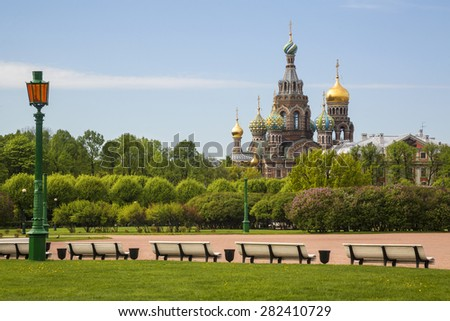 Summer view of the Field of Mars (Marsovo Polye) and Church of the Savior on Spilled Blood (Cathedral of the Resurrection of Christ) in center of Saint-Peteresburg city, Russia - stock photo