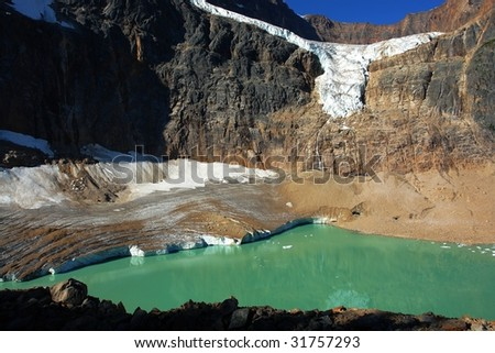 Summer view of the mountain edith cavell and glacier lake, jasper national park, alberta, canada - stock photo