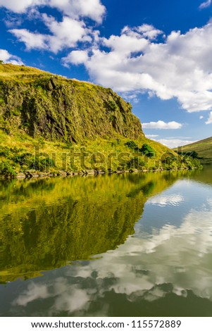 Summer view of the mountains reflected in a lake - stock photo
