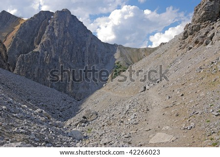 Summer view of the steep mountain louis and canyon from cory pass, banff national park, alberta, canada - stock photo
