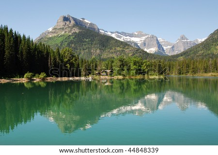 Summer view of upper waterton lake and mountains in goat haunt ranger station, glacier national park, montana, usa - stock photo
