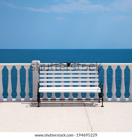 Summer view with classic white balustrade, bench and empty terrace overlooking the sea (Italy), square image - stock photo