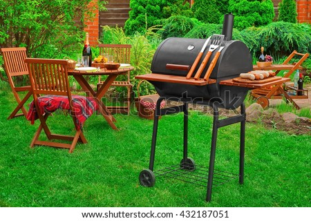 Summer Weekend Family BBQ Party Or Picnic Scene On The Lawn At The Backyard - stock photo