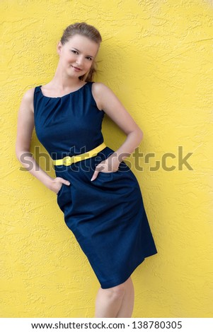 Summer woman in dress with yellow belt and pockets - stock photo