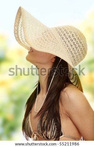 Summer woman in swimsuit and hat