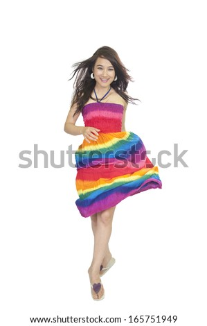 Summer woman jumping of joy excited. Beautiful mixed race woman isolated on white background. Asian Thailand and Caucasian ethnicity. - stock photo