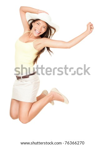 Summer woman jumping of joy excited. Beautiful mixed race woman isolated on white background. Asian Chinese and Caucasian ethnicity. - stock photo