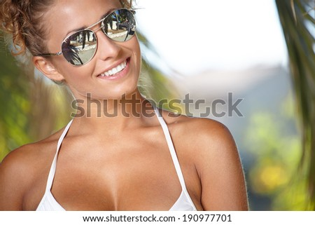 Summer woman on a background of palm trees  - stock photo