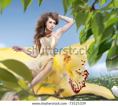 Summer woman on the flower - stock photo