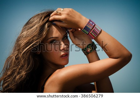 summer woman portrait with colorful  bracelets outdoor shot sunny day at beach closeup - stock photo