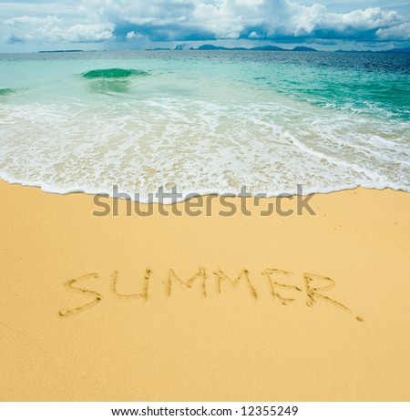summer written in a sandy tropical beach - stock photo