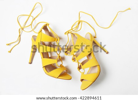 summer yellow women shoes in pan isolated with shadows - stock photo
