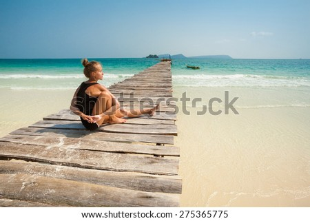 Summer yoga session on a beach - tropical Koh Rong island, Cambodia - stock photo