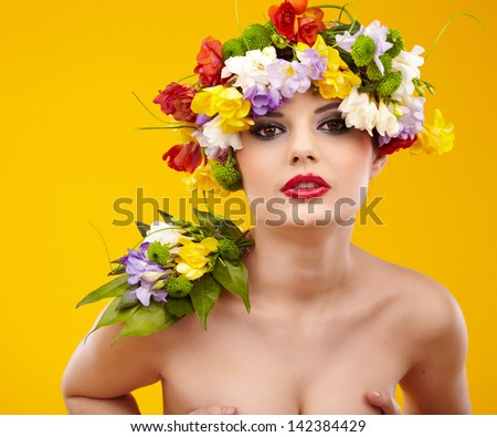 Summer young woman with colorful flowers in hair.