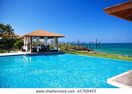 Summerhouses with swimming pool near caribbean sea, Dominican Republic - stock photo