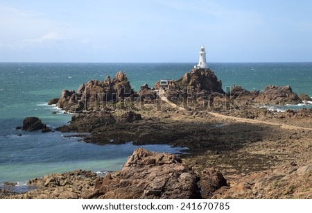 Summertime at La Corbiere Lighthouse, Jersey, Channel Island, Great Britain - stock photo