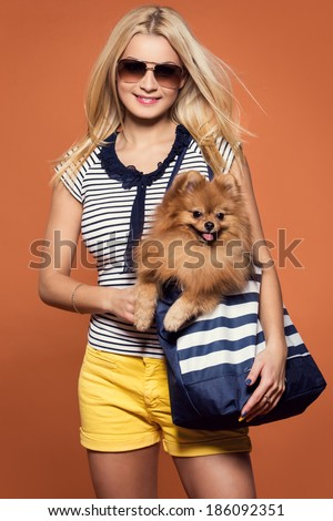 Summertime. Attractive girl with dog - stock photo