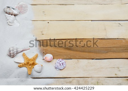 Summertime image with beach like theme of clean white sand scattered on boardwalk planks with starfish and seashells making a side border. Plenty of texture. Horizontal composition. - stock photo