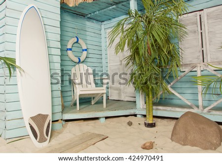 Summertime. Sandy beach. Palm bungalows on white sand beach. 