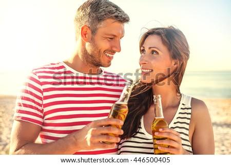 summertime travel couple enjoying sunset - stock photo