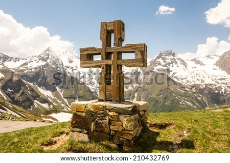 Summit cross at the Hohe Tauern mountains in Austria - stock photo