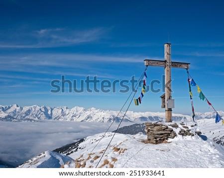 Summit cross in front Alpine landscape in Tirol - stock photo