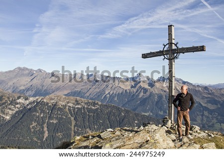 Summit cross of Jaufenspitze in South Tyrol - stock photo