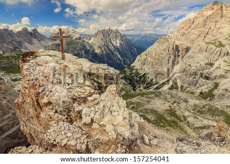 Summit cross on a Toblin tower and beautiful mountains in background Dolomites Alps,South Tyrol,Italy - stock photo