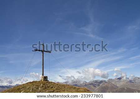 Summit cross on the 2471 m high Lahn head in the Oetztal Alps - stock photo
