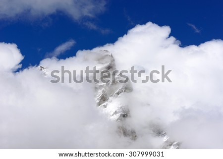 Summit of the Matterhorn in the clouds - 4478 meters - stock photo
