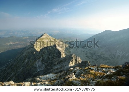 Summit on the background of the valley in the Tatras. - stock photo