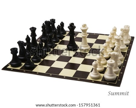 Summit. Peace negotiations at the summit level. A ready to play sets of chess and black and white kings in the middle of a chessboard.