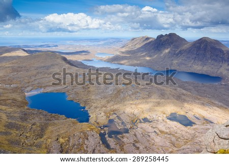 Summits of Baosbheinn and Loch a Bhealaich (right) and summits of Beinn Bhreac,Creag a Chinn Duibh (middle left) with Loch Toll nam Biast lower left. - stock photo
