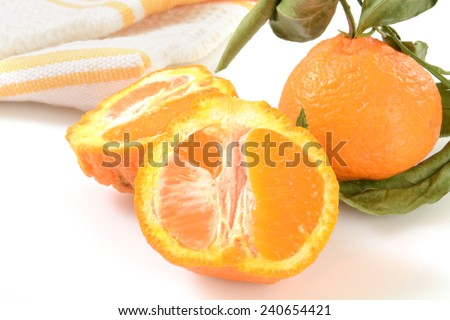 Sumo oranges on a counter, a blend between a Mandarin and California navel orange - stock photo