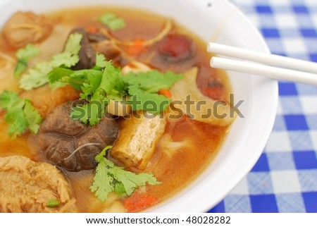 Sumptuous looking Chinese style broth with mushrooms,mock meat and radishes. Suitable for concepts such as diet and nutrition, healthy eating and healthy lifestyle, and food and beverage.