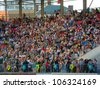 SUMY - JUNE 28: Crowd on the city stadium celebrating the Day of the Constitution of Ukraine on June 28, 2012 in Sumy, Ukraine - stock photo