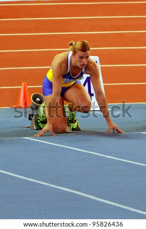 SUMY, UKRAINE - FEB.16: Dobrynska Natallia - Olympic Champion in Beijing wins the Pentathlon with National Record 4880 p. on Ukainian Track & Field Championships on February 16, 2012 in Sumy, Ukraine.