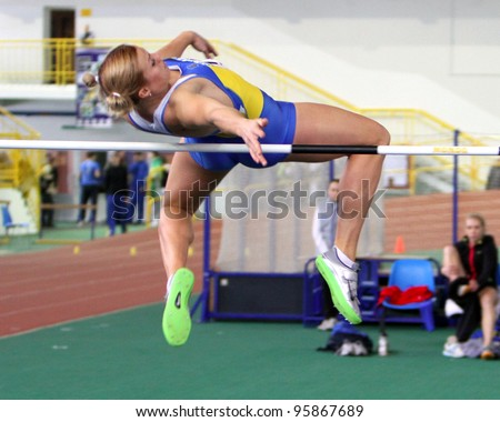 SUMY, UKRAINE - FEB 16: Dobrynska Natallia, Olympic Champion in Beijing, wins the Pentathlon with National Record 4880 p. on Ukainian Track & Field Championships on February 16, 2012 in Sumy, Ukraine. - stock photo