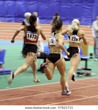 SUMY, UKRAINE - FEB.17: (L-R) Elizaveta Bryzgina, Pristupa Darina, Pigida Natalia on the finish of the 400 meters final on Ukrainian Track & Field Championships on February 17, 2012 in Sumy, Ukraine. - stock photo
