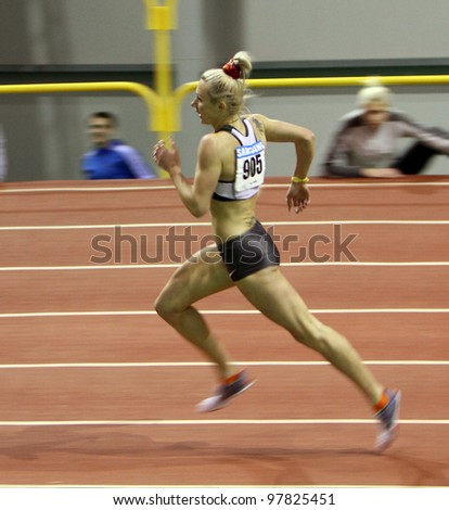 SUMY, UKRAINE - FEB.17: Petlyuk Tetiana - on the 1500 meters dash during the Ukrainian Track and Field Championships on February 17, 2012 in Sumy, Ukraine. - stock photo