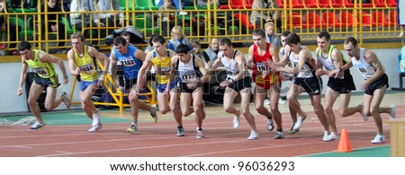 SUMY, UKRAINE - FEB 18: Unidentified men at the start of the 3,000 meters dash on Ukrainian Track & Field Championships on February 18, 2012 in Sumy, Ukraine. - stock photo