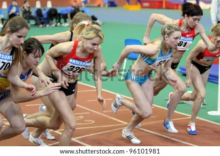 SUMY, UKRAINE - FEB 18: Unidentified women at the start of the 3,000 meters dash on Ukrainian Track & Field Championships on February 18, 2012 in Sumy, Ukraine. - stock photo